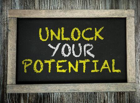 Photo pour Unlock Your Potential words on a blackboard - image libre de droit