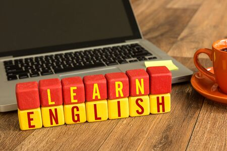 Photo pour Learn english blocks in front of a laptop - image libre de droit