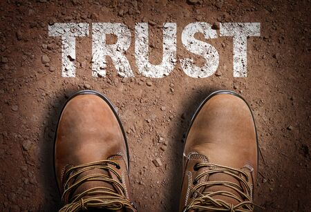 Top view of shoes with the word trust