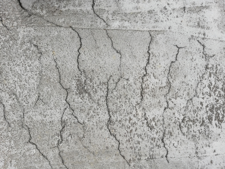 Photo pour Cracked reinforced concrete on a surface due to shrinkage in the curing process. - image libre de droit