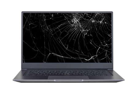 Foto de laptop with a broken, cracked screen isolated on white background close up front view - Imagen libre de derechos