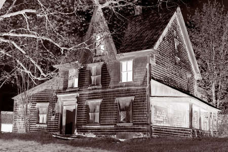 spooky, broken down, glowing abandoned house in  a rural property, great for halloween