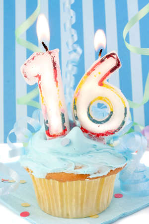 teenagers sixteenth  birthday cupcake with blue frosting and  decorative background