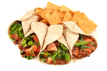Delicious and colorful mexican fajitas or wraps, and crunchy nacho chips isolated on a white background