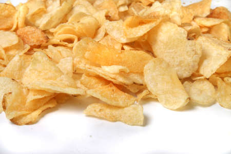 kettle chips spilling over on a white background