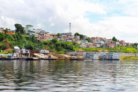 Colourful houses in a neighbourhood along the Rio Negro in Manaus, Amazonas, Brazil, South America