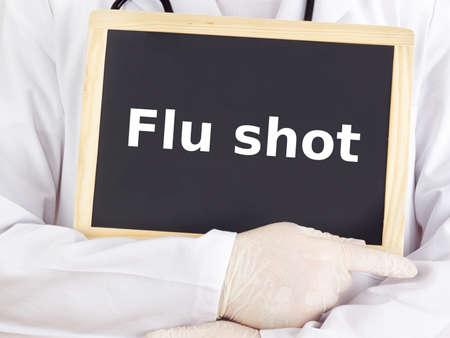Doctor shows information on blackboard: flu shot