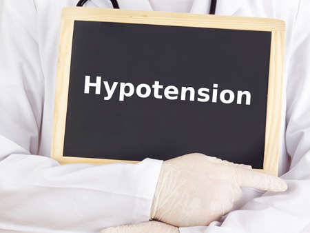 Doctor shows information on blackboard: hypotension