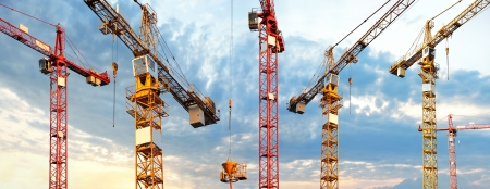 Photo pour cranes on building site in panoramic image - image libre de droit