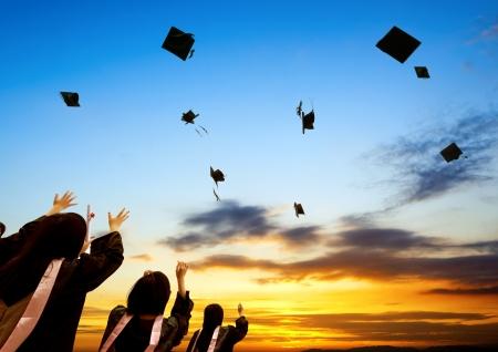 Chinese graduates and sunset sky.