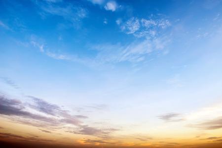 Sunrise sky blue and orange forming a border.