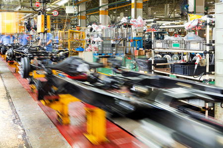 actory floor, car production line, motion blur picture.