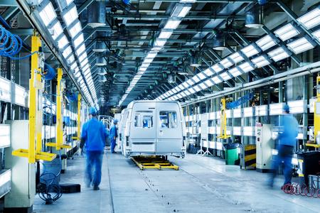 Photo pour Car production line, skilled workers are working tense. - image libre de droit