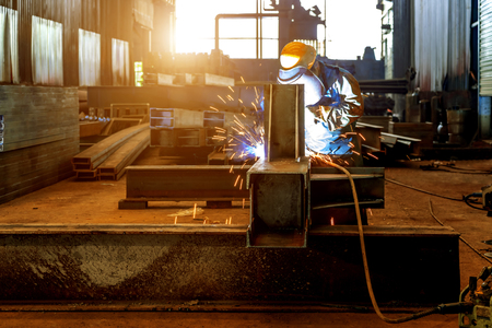 Photo pour Workers at work, ongoing welding operation. - image libre de droit