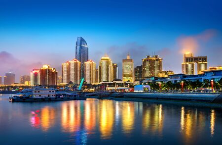 Photo pour Foggy city night view, Qingdao, China. - image libre de droit