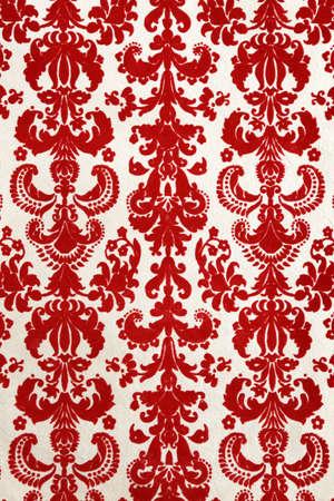 detail of red flock wallpaper pattern