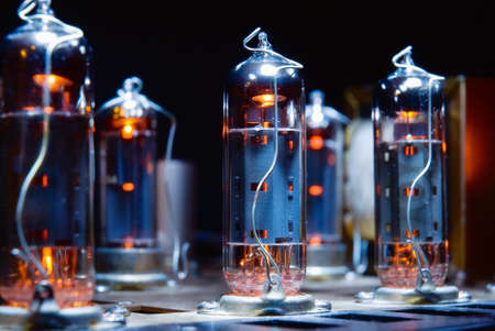 Glowing vacuum electron tubes of vintage guitar amplifier
