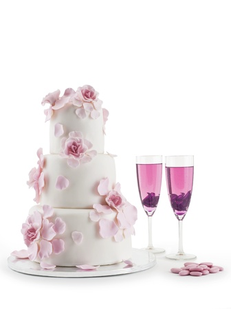Wedding cake with champagne flute isolated on white backgroundの写真素材