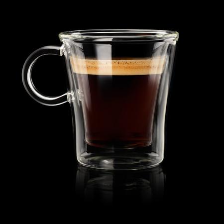 Coffee espresso doppio or lungo in transparent cup on black background