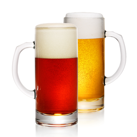 Two mugs of beer: dark and light. Isolated on white background