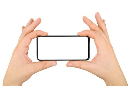 Photo pour Two hands holding bezel-less cellphone with empty screen isolated on white background. - image libre de droit