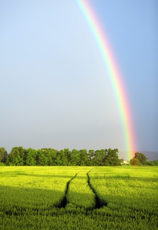 Photo pour Rainbow on  blue sky over the rural landscape - image libre de droit