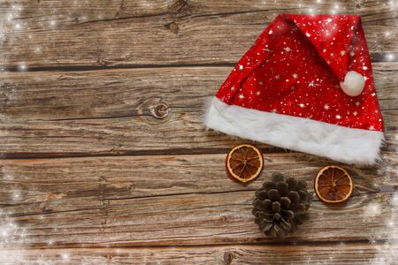 Photo for Wooden background with mandarines and Christmas hat on the table. Winter holiday frame. Flat lay top view. copy space - Royalty Free Image