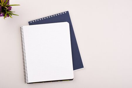 Photo pour Planner on the grey wooden working table. Blank white paper on working desk - image libre de droit