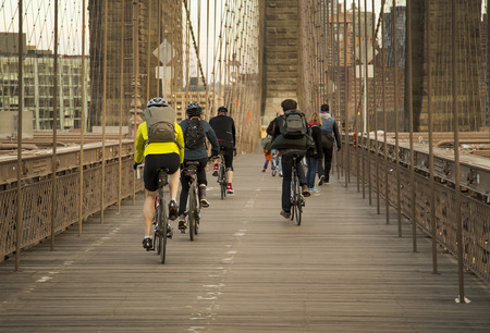People ride thier bikes on Brooklyn Bridge Afternoon