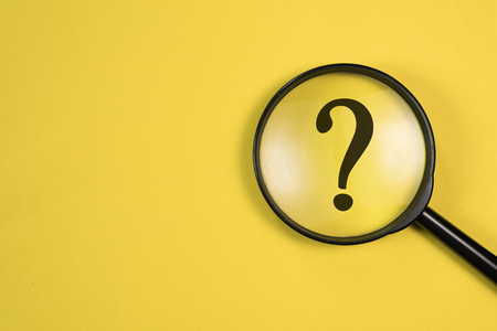 Photo pour Magnifying glass with QUESTION MARK in focus on yellow background. concept of search and research. - image libre de droit