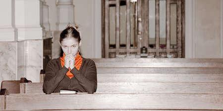 girl pray in a catholic church
