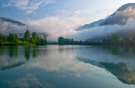 Amazing view of reservoir on Soca (Isonzo) river near Most na Soci (Bridge on Soca - Santa Lucia d'Isonzo), Slovenia at foggy morning. Soca river - popular place for active recreation in Julian Alps