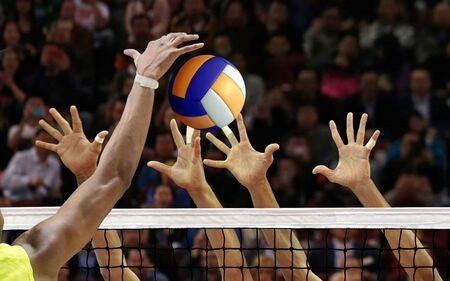 Photo pour Volleyball spike blocking in front of  the net - image libre de droit