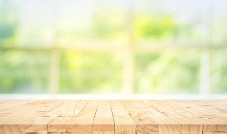 Photo for Empty wood table top on blur abstract green garden from window view in the morning. For montage product display or design key visual layout - Royalty Free Image