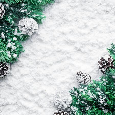 Foto de Christmas ornament with pine branch on snow background For christmas concepts or new year,winter ideas.Flat lay template design - Imagen libre de derechos