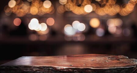Foto de Wood texture table top (counter bar) with blur light gold bokeh in cafe,restaurant background.For montage product display or design key visual layout - Imagen libre de derechos