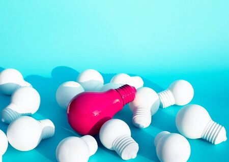 Photo for Ideas inspiration concepts with only one of lightbulb outstanding on another lightbulb on blue color background.Business creativity.motivation to success.minimal style. - Royalty Free Image