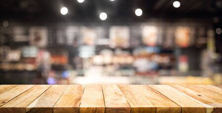 Photo pour Wood texture table top (counter bar) with blur  cafe,restaurant background.For montage product display or design key visual layout - image libre de droit