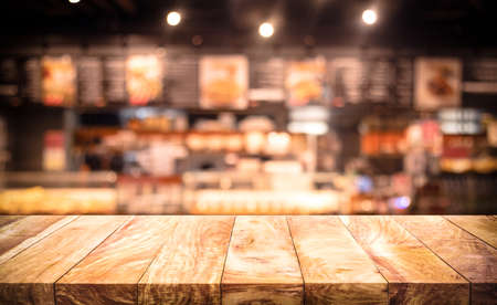 Photo pour Wood table top (Bar) with blur light bokeh in dark night cafe,restaurant background.Lifestyle and celebration concepts ideas - image libre de droit