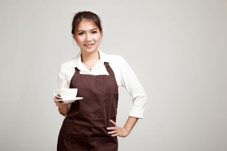 Photo pour Waitress or barista  in apron  holding coffee - image libre de droit