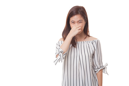 Photo pour Young Asian woman  holding her nose because of a bad smell isolated on white background - image libre de droit