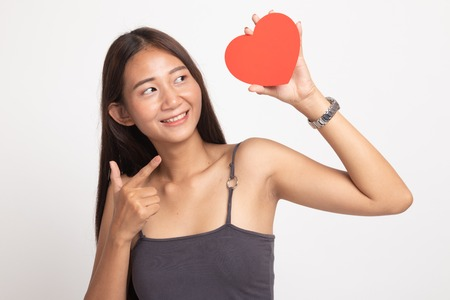 Photo for Asian woman point to red heart on white background - Royalty Free Image
