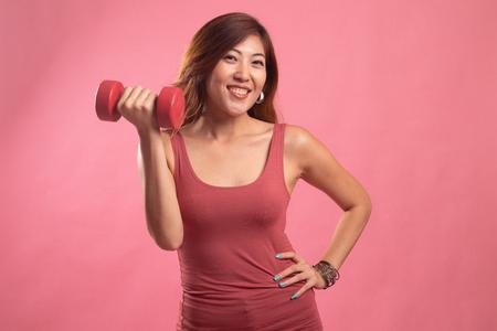 Foto für Healthy Asian woman with dumbbells on pink background - Lizenzfreies Bild