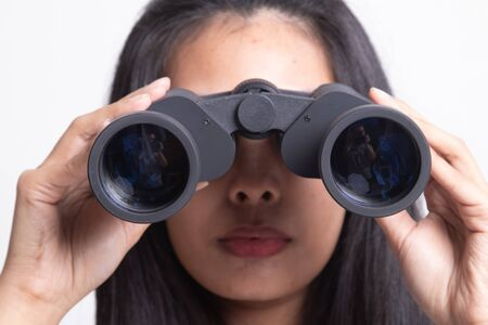 Photo for Young Asian woman with binoculars on white background - Royalty Free Image