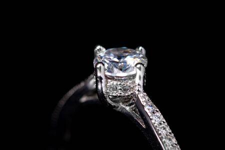 Photo pour Close up  of diamond silver ring on black background - image libre de droit