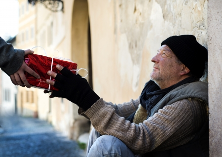 Photo for Christmas gift for homeless man - Royalty Free Image