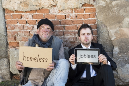 Photo for Homeless men are begging on the street. - Royalty Free Image