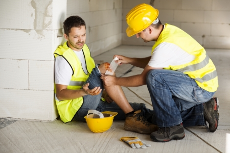 Photo pour Construction worker has an accident while working on new house - image libre de droit