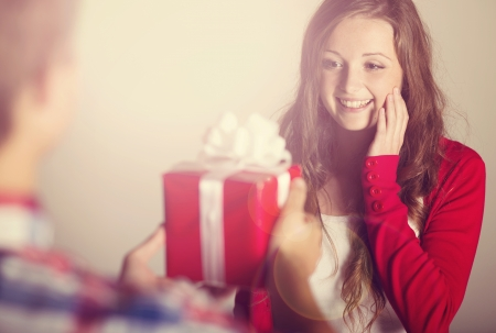 Beautiful woman with gift
