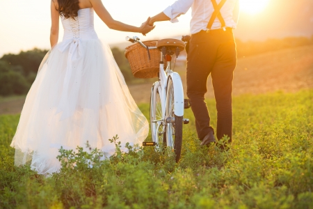 Beautiful bride and groom wedding portrait with white bike